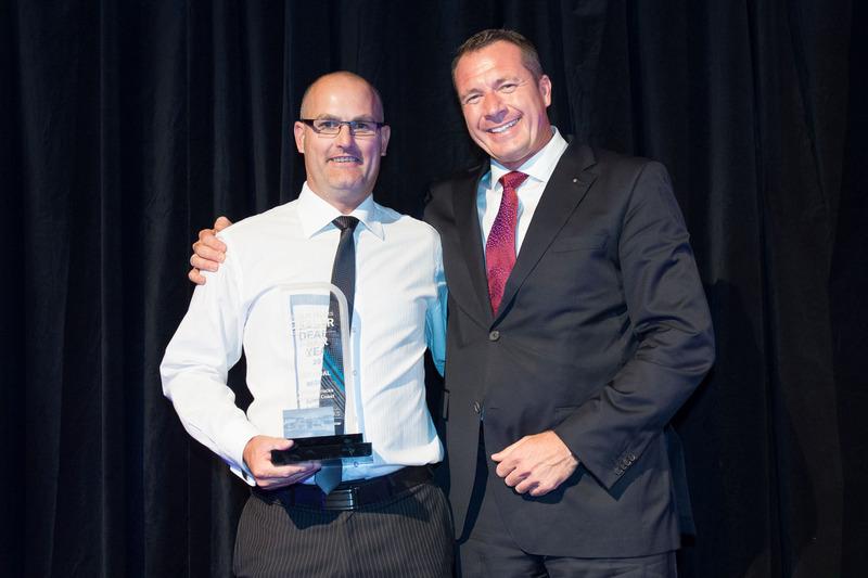 Gregory Gardiner of Daimler Trucks getting an award