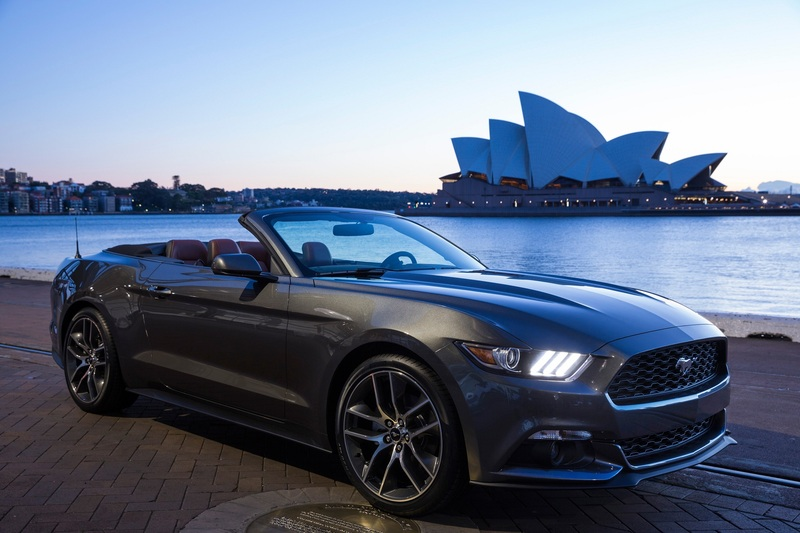 Silver Ford Mustang near the Sydney Opera House