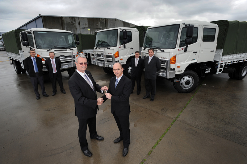 Mike Smith, Hino Corporate Business Manager, presents the keys of a new GT 4x4 Crew Cab to Bob Den Hartog, Director - Commercial & General Service Vehicles for the ADF