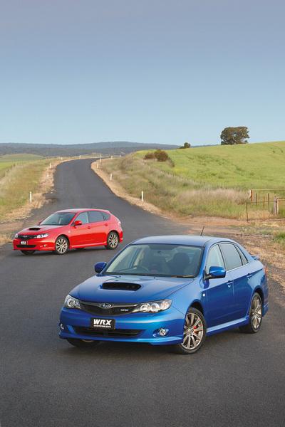 A red and a blue Subaru Impreza WRX