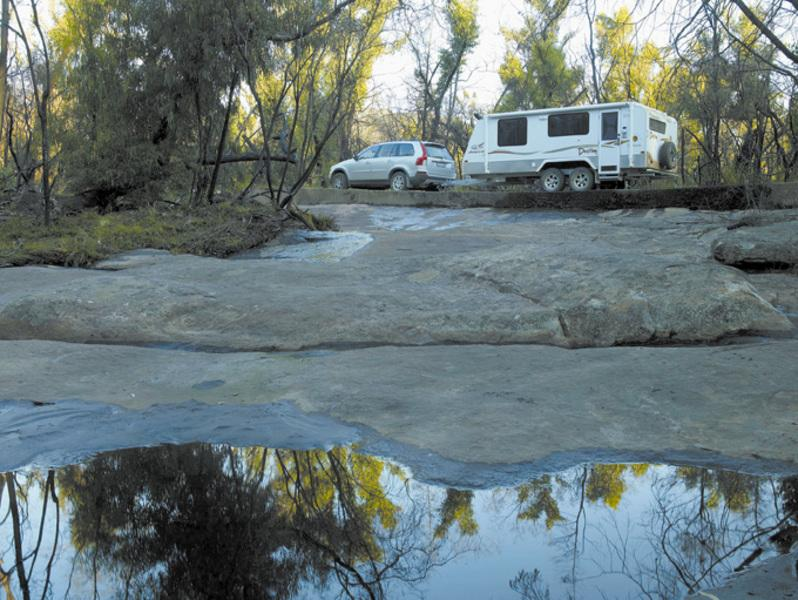 Jayco Destiny being towed above a pond