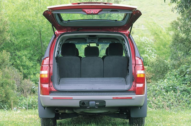 Red 2001 Ford Explorer tailgate up