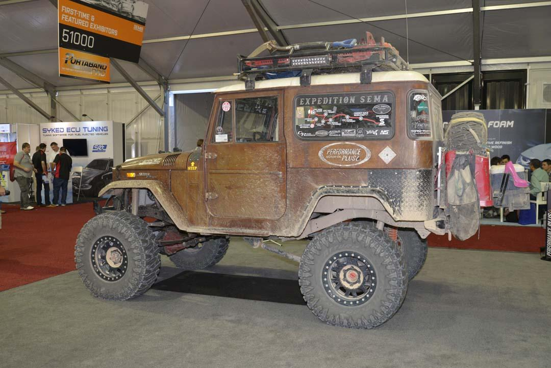 "'Expedition SEMA' FJ40 LandCruiser was built by The Garage Shop in North Carolina and actually went on an ""expedition"" to SEMA, taking on all the dirt roads, abandoned areas and offroad trails it could find between Missouri and Las Vegas in a 6,000km, six state, 20-day trek, hence it's ""used"" appearance!"