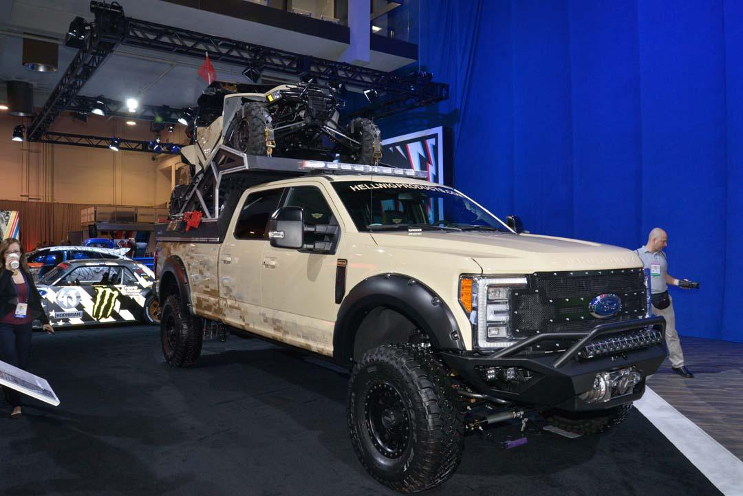 "Dubbed ""The Operator"", this F-350 Lariat 4x4-based rig was described as the ultimate recon adventure vehicle. With an Arctic Cat 'Wildcat' UTV in the back and Hellwig air springs and sway bars underneath, this Super Duty F-350 also featured Method Race wheels, Falken offroad tyres, custom bumpers and a bunch of additional kit in the tray."